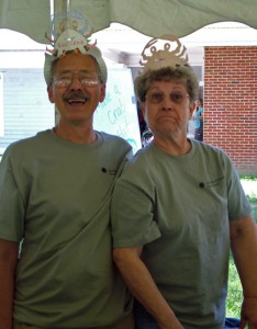 Photo of two volunteers wearing homemade crab-hats