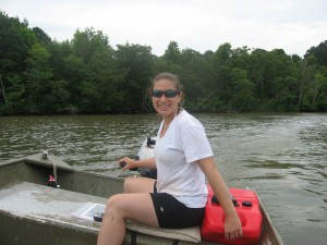 Paige at the helm of our trusty jon boat.