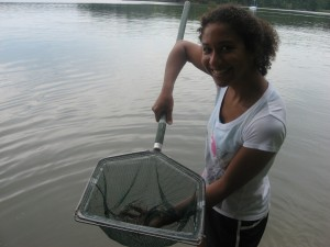 Sara shows off a sweep net full of grass shrimp