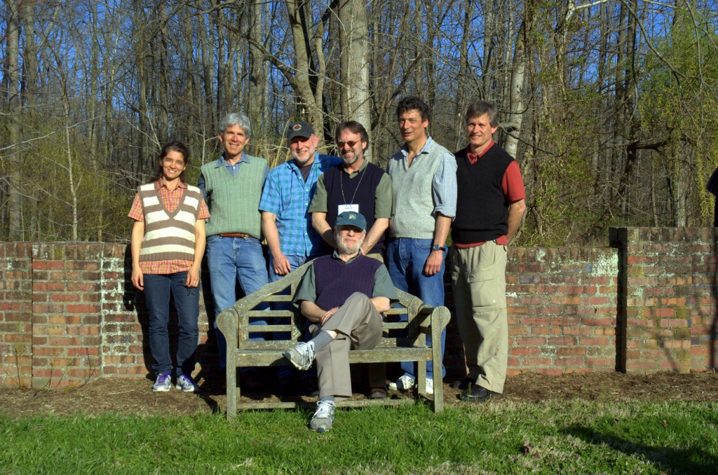 Photo: Jim Carlton sits in front of his former postdocs, including SERC's Greg Ruiz (second from right). By Kim Holzer