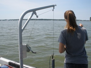Measurement devices hang off the boat from this pulley system to collect data such as water pH, temperature, salinity, and oxygen level.