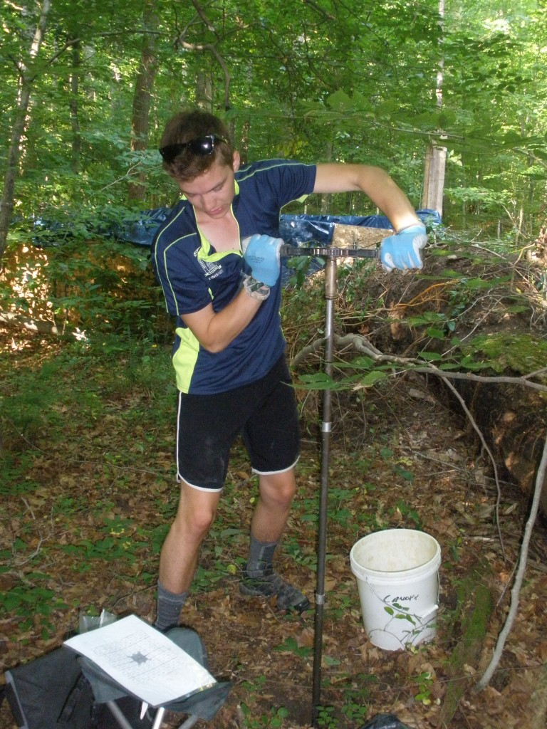 James Biddle, SERC intern, twists a soil augur into the ground to collect a 50 to 100 cm deep soil core.