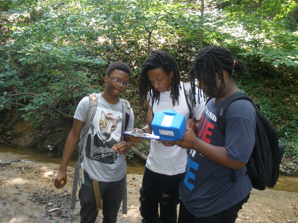 "POWER participants Kofi Henderson (left), Zinquarn ""Zee"" Wright (center), and DeAnthony Simpkins record stream data."