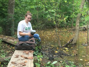 SERC intern Lauren Mosesso takes a water quality reading