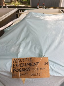 "Intern Michelle Hauer's experimental tank setup during recording stage. Sign over tank says, ""ACOUSTIC EXPERIMENT IN PROGRESS--please use quiet voices!"""
