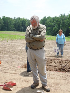 Jim Gibb stands at soil excavation