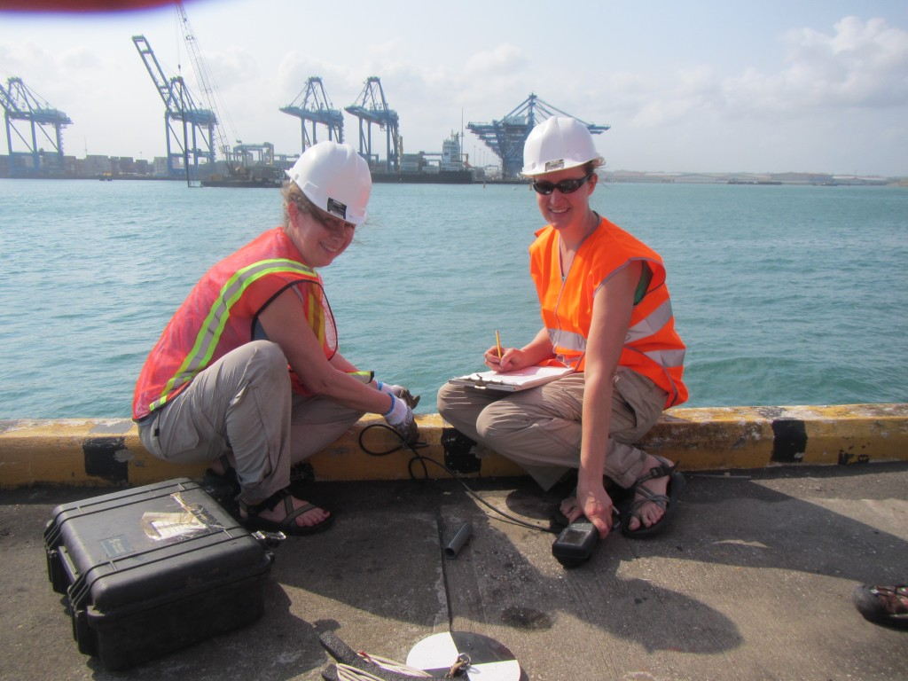 Linda McCann (left) and Kristen Larson take salinity and temperature readings at the dreaded Colon Container Terminal. (SERC)