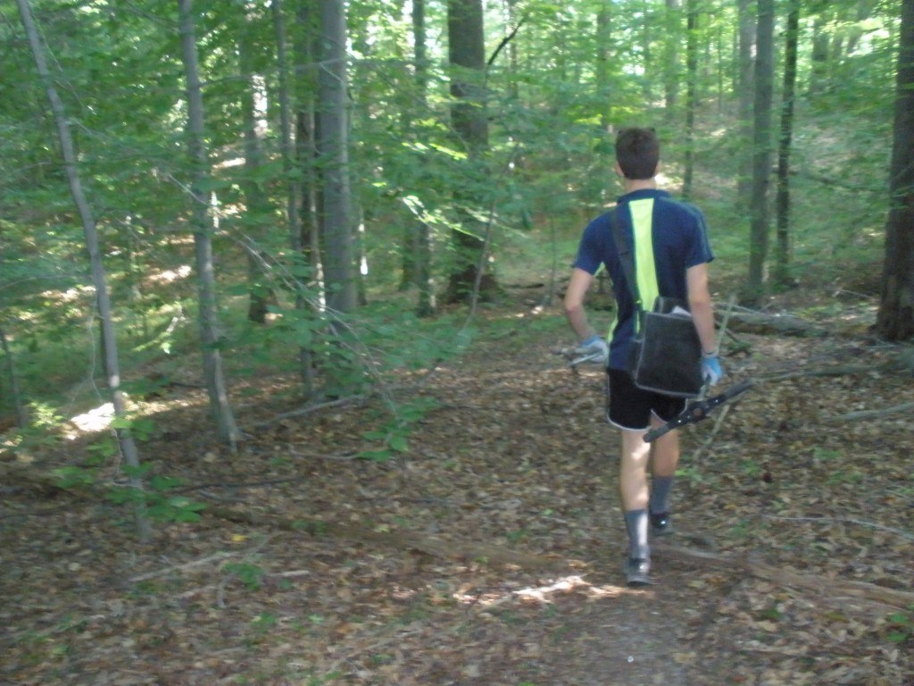 Biddle heads into SERC's ForestGEO plot for a morning of soil sample collection.
