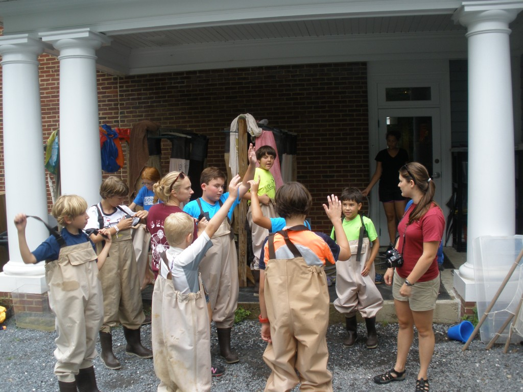 """""""Who's been seining before?"""" asks Anna Youngk, SERC education intern and camp counselor."""