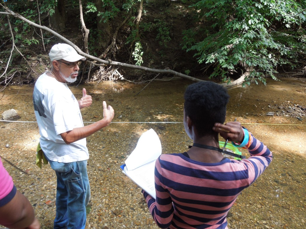 Tony Thomas explains one of the stream sampling methods to Latasia Carter, who recorded the group's data on this visit.