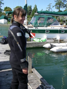 Christina Simkanin prepares to dive into a marina to survey for ascidians