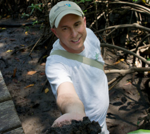 Scientist holds fistful of soil