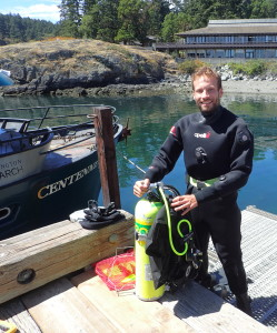 Ross Whippo on dock with diving gear