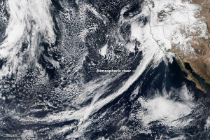 A big band of clouds stretches from Hawaii to the western coast of North America.