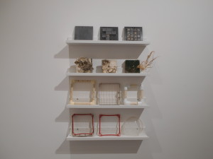 four shelves with various square plastic panels or frames made of pvc.