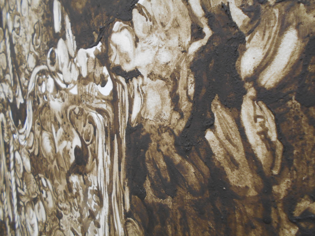 close view of gritty brown mud-paint on a white canvas