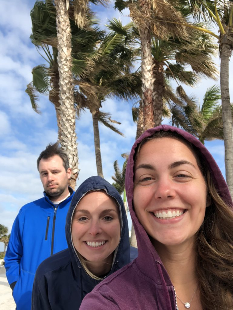 Selfie of three scientists with palm trees